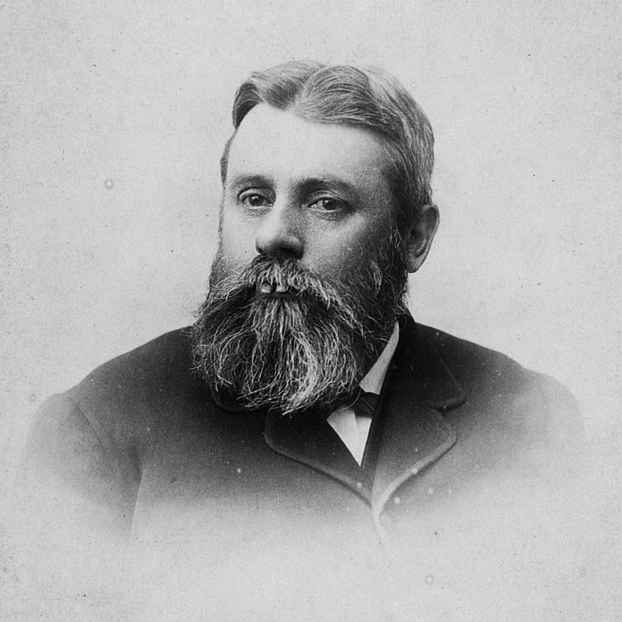 Photograph of Samuel J Reynolds, the founder of the Reynolds family business wearing a black suit