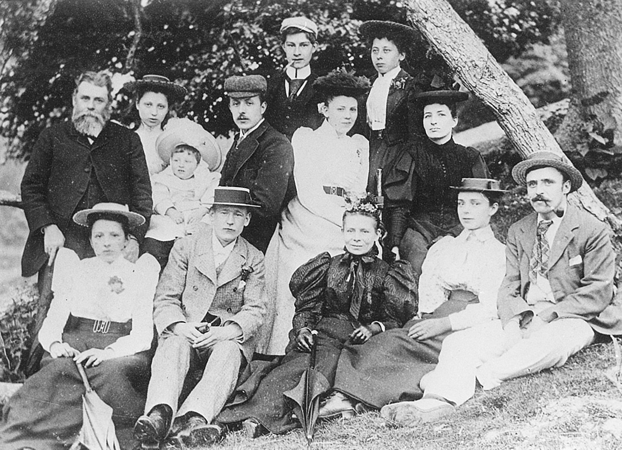 An old black and white group family photo taken in a garden whilst Samuel was still alive
